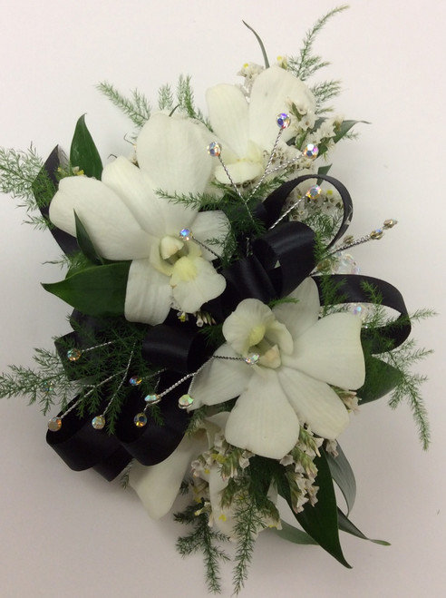 Orchid corsage in whites and black