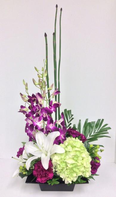 Orchid and stargazer zen arrangement