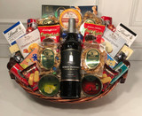 Wine gift basket with nuts cheese chocolates and snacks.