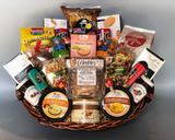 "Spread the joy and send some cheer! This basket is so ""Over The Top""! We have packed many of our best seller in this one, so to make it simple we'll just list the content from back to front… so here we go. Unique pretzel splits, a pair of Destrooper cookies, Loacker imported wafer cookies, chocolate and vanilla Hit cookies, Crimson Cup award winning coffee, a pair of savory grab 'n go snacks from Glacier Ridge, two County Kettle preserves, two beef summer sausage, milk and dark Lindt chocolate bars, Plumrose ham, Sugarbush cashews and ranch mix, pepper jack, smoked gouda and cheddar bacon cheese spreads, chocolate covered pretzel bites, Sugarbush caramel corn, Mrs. Crimble's coconut macaroons, delicious tailgate mix form Virginia Diner, the best ever Country Kettle cashew crunch and lots of Lindor chocolate truffles. Tastefully arranged in a large handled basket.    Now that is way over the top!  Perfect for a family or office…want to add a bottle of wine or two to this feast?  Call us and we'll custom make it for you. (800) 837-2929"