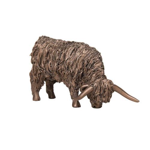 Bronze Cow Grazing