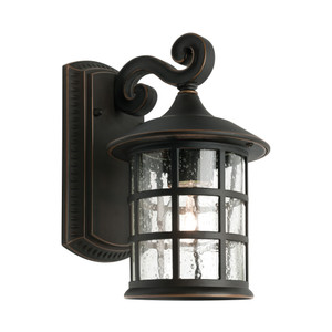 Small Traditional Exterior Wall Light. Lantern Shape with Clear Stippled Side Glass and Bronze Finish.