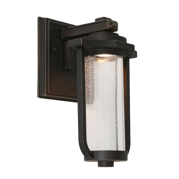 Traditional yet Modern Die Cast Aluminium LED Exterior Wall Light with Clear Stippled Cylinderical Glass. Perfect for Entranceways and Exterior Walls.