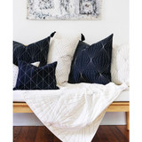 Organic cotton quilted throw with geometric prism design sustainably handmade in India