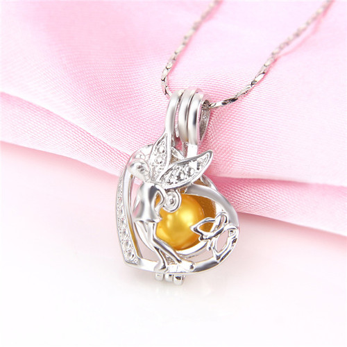 Fairy with butterfly pendant