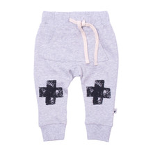 Milk & Masuki Baby Trackies with Roo Pocket - Black Knee Cross