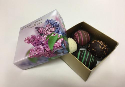 4 piece dessert truffles: Irish cream (dark chocolate), raspberry (milk chocolate), sea salt caramel (white chocolate), tiramisu (dark chocolate).