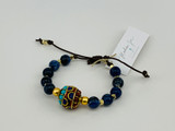 SODALITE AND TIBETAN BRASS WITH LAPIS, TURQUOISE, AND CORAL BRACELET ON LEATHER