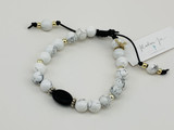 HOWLITE, ONYX, AND SILVER PLATED BEADS BRACELET ON LEATHER