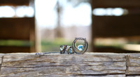 Sterling Silver with Hammered Bronze Accents and Large Blue Topaz Stone