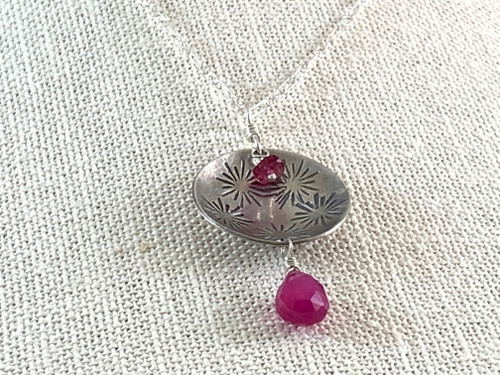 Sterling Silver Stamped Round Necklace with Pink Rubies