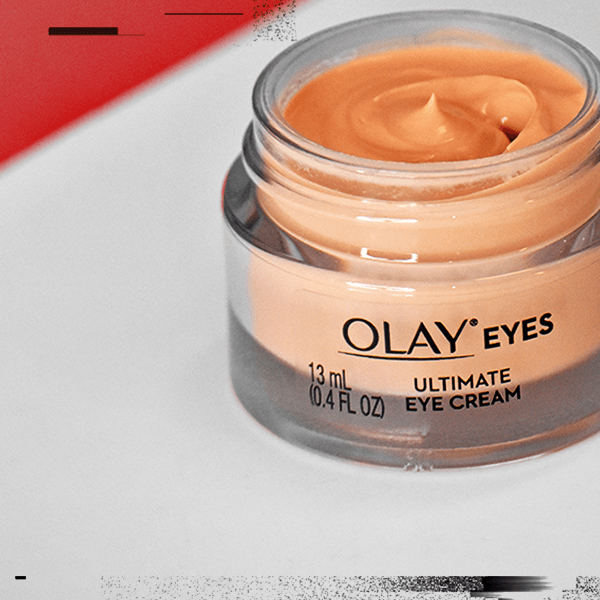 Open jar of Ultimate Eye Cream floating on light gray background with black accents. Promo reads: Extra $2 OFF one eyes product with code EYES.