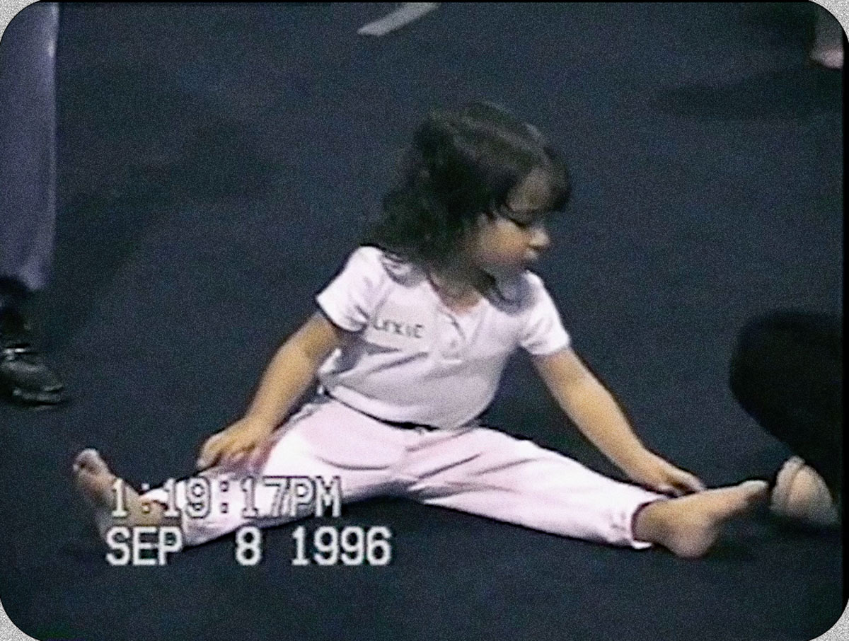 Young Aly dusts her hands with chalk imagining herself doing all the moves.