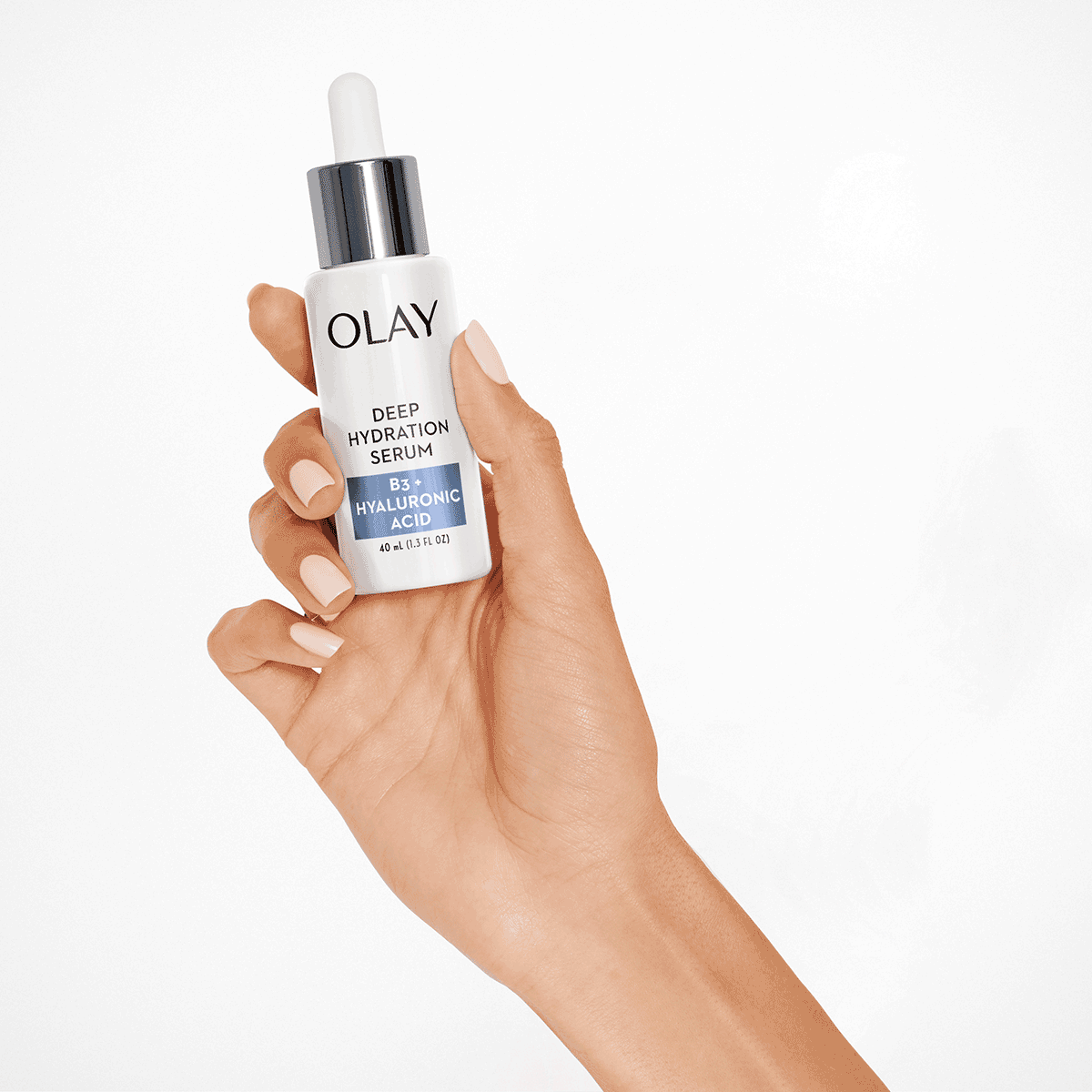 holding tone perfection serum in hand