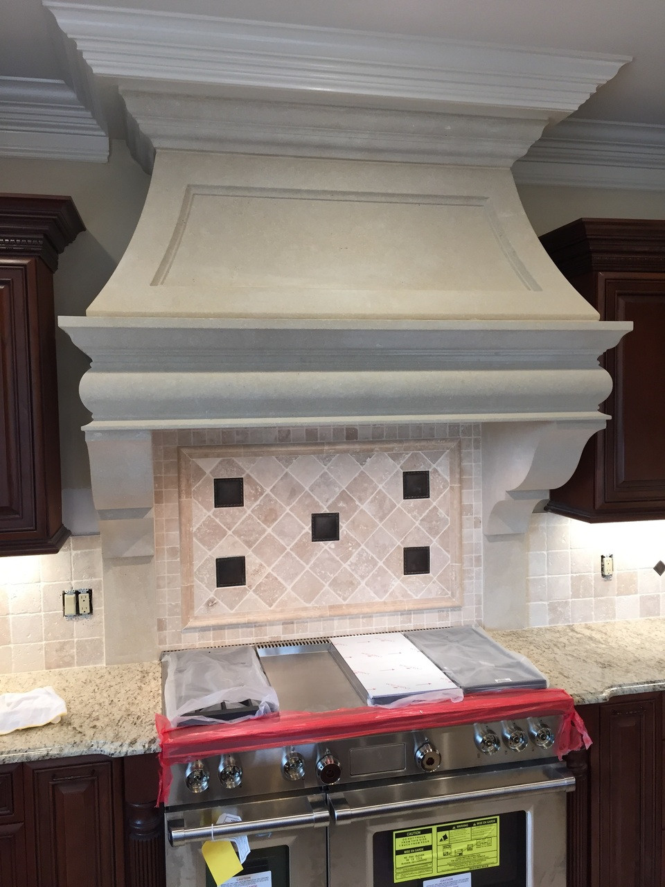 The Williamsburg 48 Inch Range Hood - carved from natural Silverdale limestone