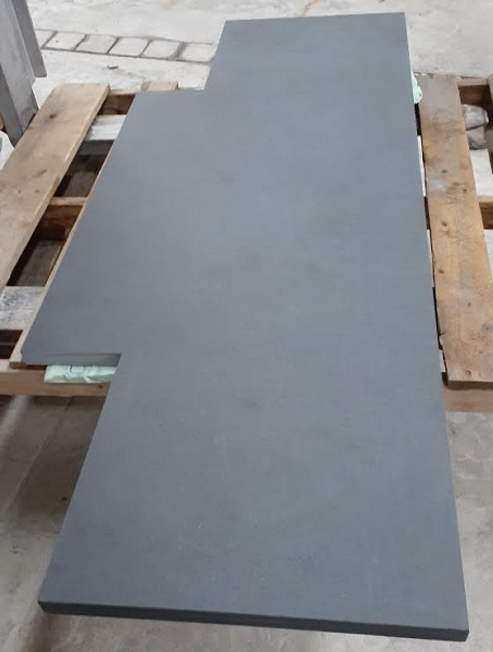 Black slate fireplace hearth with natural cleft top cut out for fireplace opening
