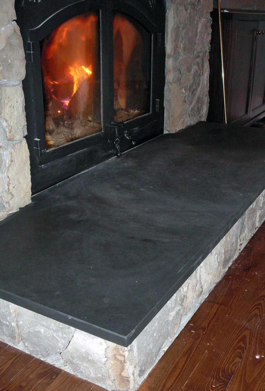 Honed black slate fireplace hearth.
