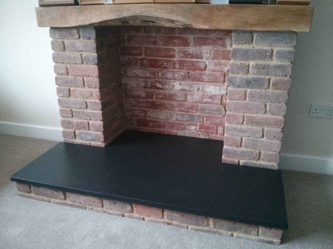 Custom slate fireplace hearth slab; available in honed, sandblasted and other finishes; natural stone; made in the USA; hearth pad; one piece