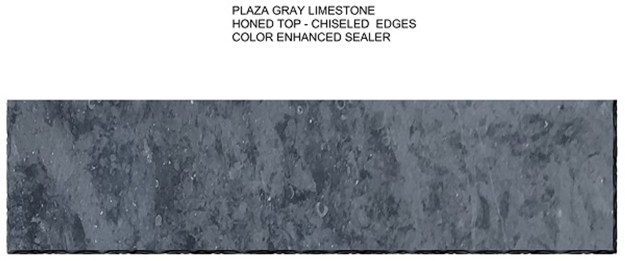 Plaza Gray limestone fireplace hearth; color enhanced to make the stone darker; honed smooth top with chiseled edges. Top view