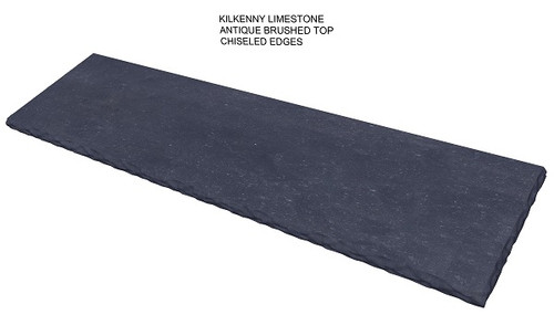 Kilkenny Limestone fireplace hearth antique brushed finish top; chiseled edges.