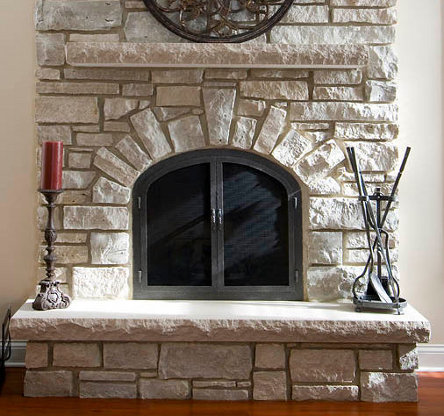 Indiana buff limestone fireplace hearth with chiseled edges.