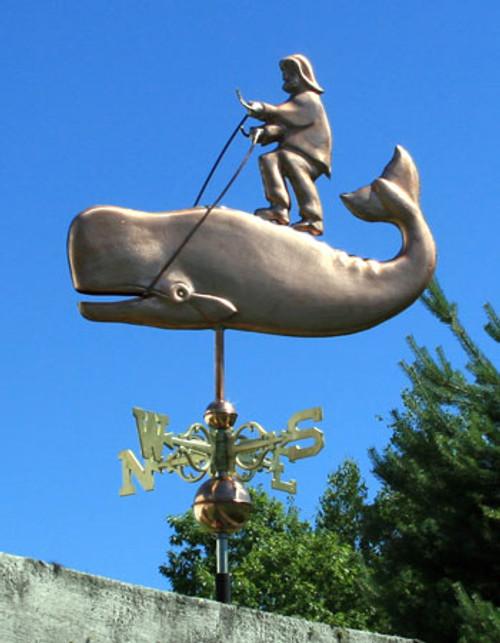 man riding a whale weathervane
