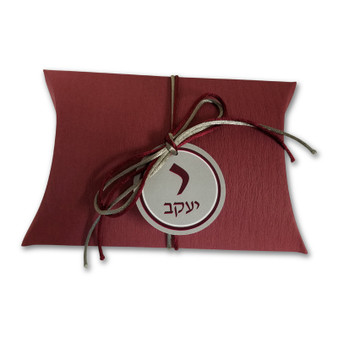 Burgundy pillow box with cord and tag