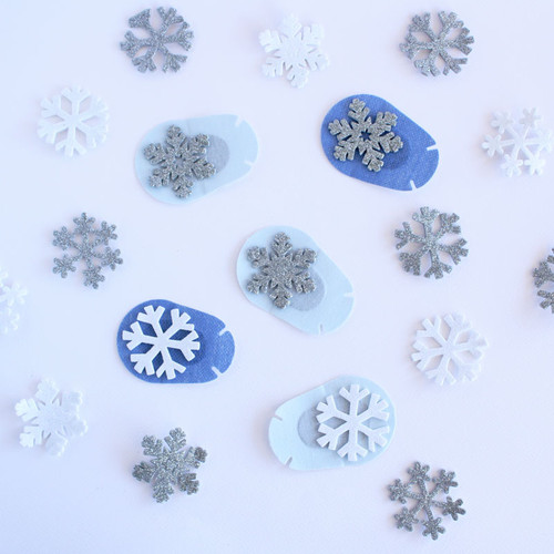 Glitter snowflake stickers perfect for adhesive eye patches