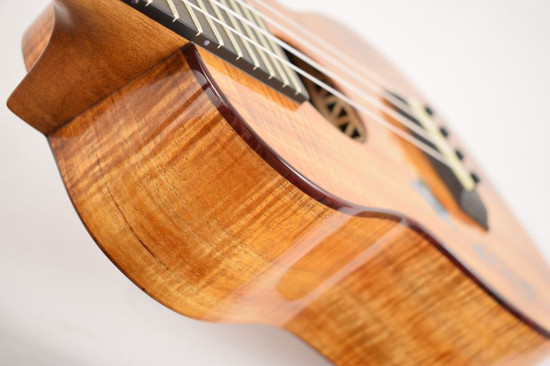Kanile'a ISL-C-PREM : Premium Curly Hawaiian Koa Concert Ukulele with Hawaiian Islands Inlay (24199) - Sides
