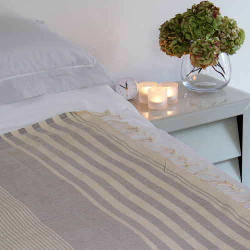 Blue and White striped organic hammam towel on bed