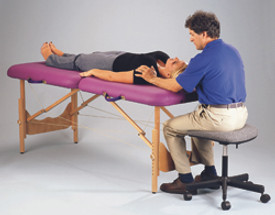 Pisces Pro New Wave II Hardwood Massage Table in use