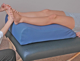 Custom Craftworks Massage Table Bolster, Classic Reflexology in use