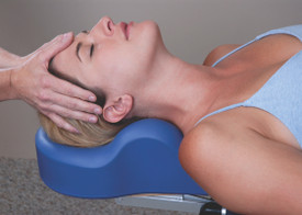 Custom Craftworks Massage Table Cervical Relief Pillow, OMNI, in use for a facial