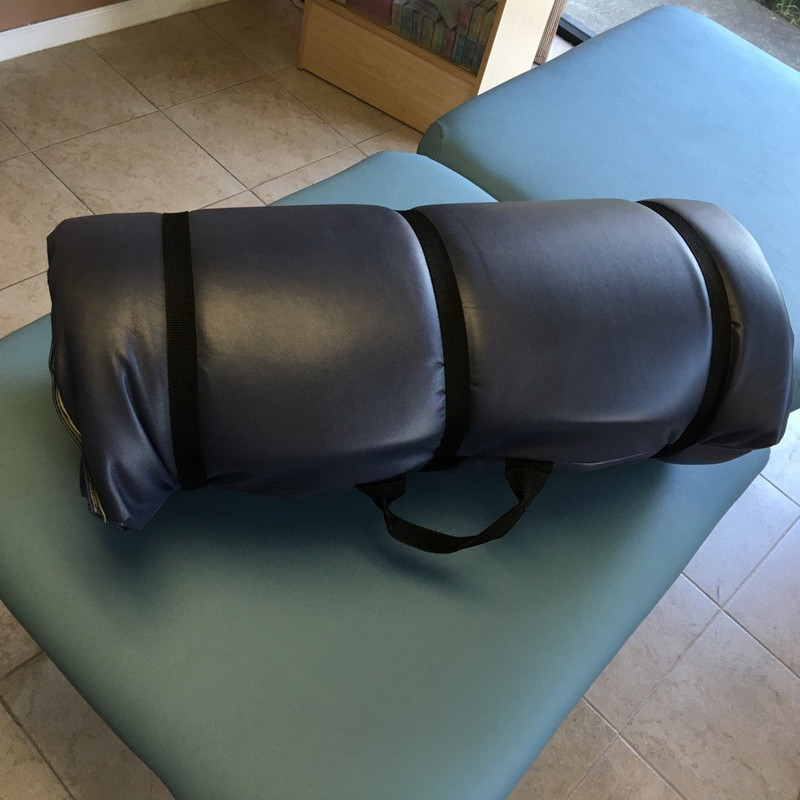 Pisces Pro Massage Table and Floor Comfort Mat Rolled Up