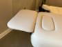 Oakworks Massage Table Boiance Shelf being used as a headrest
