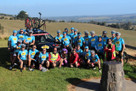 Tour De Cure team with support vehicle in background fitted with a SeaSucker Bomber 3-Bike Rack