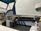 SeaSucker Horizontal Rod Holder installed along the gunnels of a Haines Hunter 560F