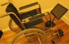 SeaSucker Black iPad Galaxy Mount attached to a wheelchair