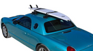 SeaSucker Roof Rack / Board Rack on car transporting a surfboard
