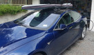 SeaSucker Roof Rack / Board Rack on a Tesla Model S