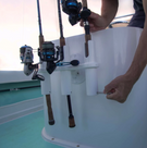 SeaSucker Pro Series 2-Rod Holder mounted inside the boat with two fishing rods being transported