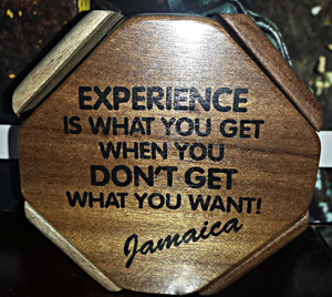 """Handcrafted in Jamaica with the addition of 'inspiring' phrases. They include: """"A man's gotta believe in something! I believe I'll have another drink!!"""" """"Jamaica where big wood grows wild & free"""" """"Onnu backside!"""" """"Life without humor is no life at all!!"""" """"Some friends of mine visited Jamaica and all they brought home for me was this ridiculous piece of wood! Guess I'll have to visit there myself and bring back some of the good stuff!!"""""""
