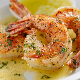 Cooked colossal  U-15 count peeled and deveined tail on wild caught USA American Gulf shrimp