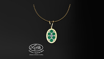 This simple, fashionably framed 11X13 mm oval, two part design accentuates a crafted reflective center setting supporting a.03 ct round diamond and genuine emerald gemstones. Hand selected by experts for their brilliance, rich color and eye catching appeal. We believe as you do … Be it; birthday, anniversary or just because… she deserves the best. Your choice of 10 or 14K gold, white, yellow or two tone. Chain not included but available on request, Ask us for details.