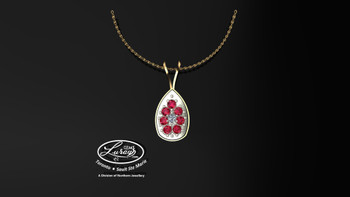 This simple, fashionably framed 13X17mm pear, two part design accentuates a crafted reflective center setting supporting .06 ct round diamond and genuine ruby gemstones.  Hand selected by experts for their brilliance, rich color and eye catching appeal.  We believe as you do …  Be it; birthday, anniversary or just because… she deserves the best.  Your choice of 10 or 14K gold, white, yellow or two tone.  Chain not included but available on request, Ask us for details.