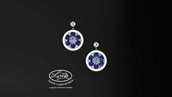 These simple, fashionably framed  11mm round, two part design, accentuate the crafted reflective center setting supporting .03ct center surrounded by genuine blue sapphire gemstones.  Diamonds and gemstones are selected by experts for their brilliance, rich color and eye catching appeal.  Suspended on 3mm drop down ball studs with secure butterfly clasps, these stunning pieces will catch the light with every movement.  We believe as you do …  Be it; birthday, anniversary or just because… she deserves the best.