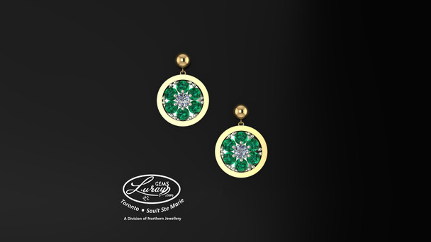 These simple, fashionably framed  11mm round, two part design, accentuate the crafted reflective center setting supporting .03ct center surrounded by genuine emerald gemstones.  Diamonds and gemstones are selected by experts for their brilliance, rich color and eye catching appeal.  Suspended on 3mm drop down ball studs with secure butterfly clasps, these stunning pieces will catch the light with every movement.  We believe as you do …  Be it; birthday, anniversary or just because… she deserves the best.