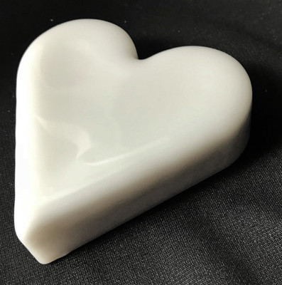 Cast art glass heat paperweight in white opalescent