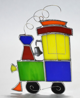 Green, red, blue, yellow, and orange toy train suncatcher