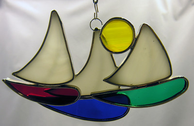 Trio of Sailboats art glass suncatcher in red, white, blue, green, and yellow